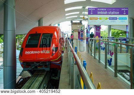 SINGAPORE - CIRCA JANUARY 2016: The Sentosa Express monorail line connecting Sentosa island to HarbourFront on Singapore mainland. Train at Imbiah Station.