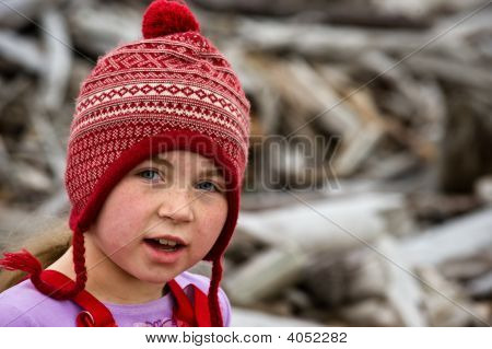 Girl In Stocking Cap Beach Combing