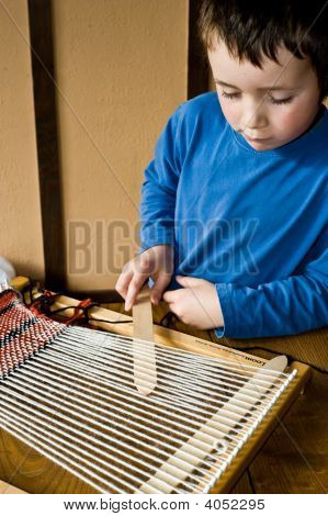Boy Using Loom