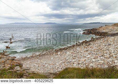 Seascape Of One Of The Stony Beaches Of La Coruna, Near The Torre De Hercules, In The North Of Galic