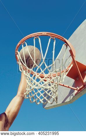 Basketball player Dunking the Ball