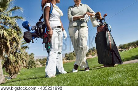 Female golfers talking on the golf course