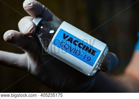 Coronavirus Vaccine In The Doctor's Hand. Vaccination Concept.