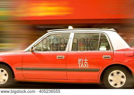 Central District, Hong Kong, China, Asia - December 12, 2008: Panning Of A Taxi In The Streets Of Ho