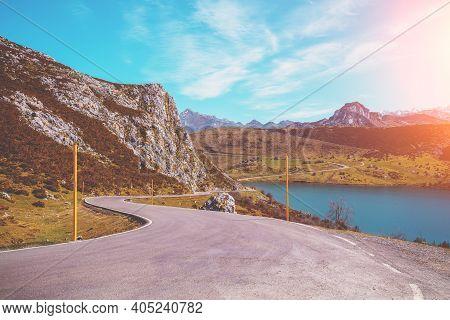 Beautiful Mountain Landscape. The Road Along The Glacial Lake Enol. Peaks Of Europe (picos De Europa