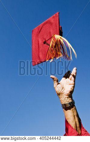 Senior Graduate Tossing His Mortarboard