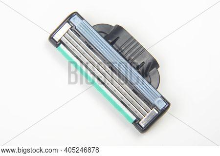 Razor Cassette On White Background. Manual Face Shaving Machine. Stubble Blade. Depilation