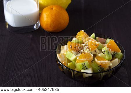 Close-up Fruit Salad In Bowl. Refreshing Fruit Salad With Lemon. Healthy Fruit Salad With Green Mint