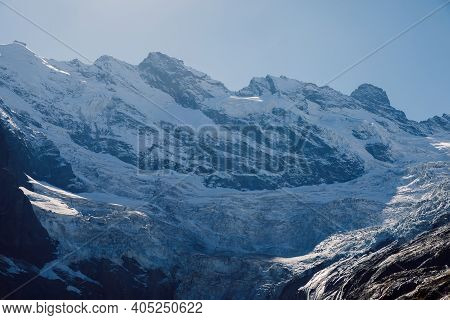Rocky Mountains With Glacier And Snow. Peak Of Mountain And Ice Glacier