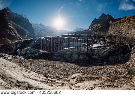 Glacier And Rocky Mountains. Peak Of Mountain And Ice Glacier In Dombay