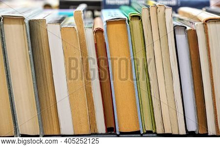 Row Of Many Old Used Books Displayed At Local Antiquarian Bookshop, Shallow Depth Of Field Photo, On