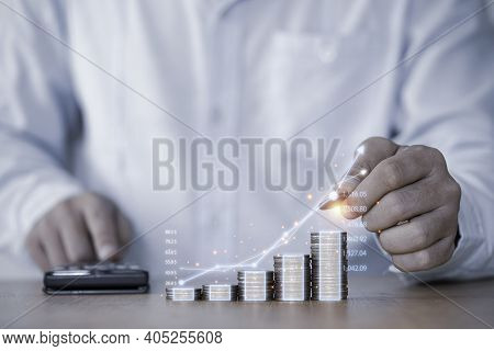 Businessman Hand Drawing Virtual Increasing Graph With Money Coins Stacking , Business Investment Pr