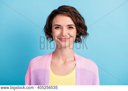 Close-up Portrait Of Attractive Cheerful Brown-haired Girl Wearing Knitwear Isolated Over Bright Blu