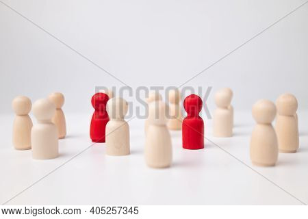 A Wooden Figure Standing With A Team To Influence And Empowerment. Concept Of Leadership, Successful