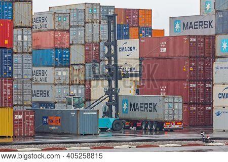 Koper, Slovenia - January 13, 2017: Loading Container At Cargo Port In Koper, Slovenia.
