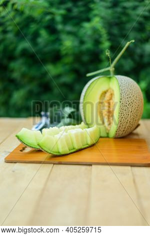 Closeup Focus To Fresh Green Melon On Wood Plate