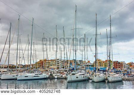 Tenerife, Spain - December 14, 2019: Sail yachts at Marina del Sur in Las Galletas