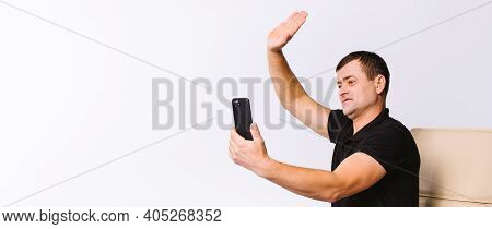 Banner, Long Format. Caucasian Man Communicates Non-verbally Via Video Communication, Greets While S