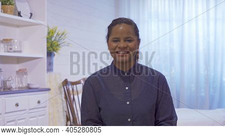 Portrait Of Smiling Business Black Woman, African American Person Working From Home And Talking To H