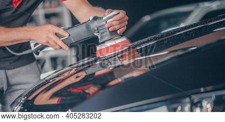 Process Of Car Detailing By Hand Polisher, Polishing The Car In The Studio, Car Care Concept