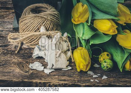White Easter Rabbits And Fresh Yellow Tulip Flowers, Toned