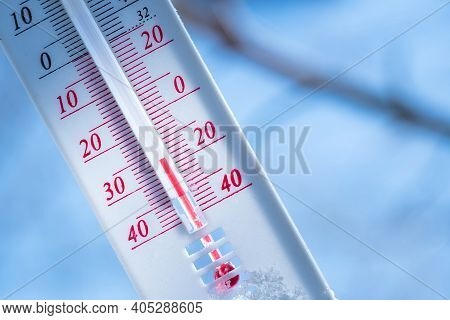 The Thermometer Lies On The Snow In Winter Showing A Negative Temperature. Meteorological Conditions