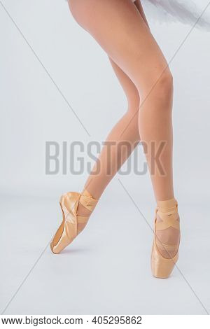 Lower Half Waist Down Image Of Ballerina Dancing On Pointe. Close-up Classic Ballerina's Legs On The