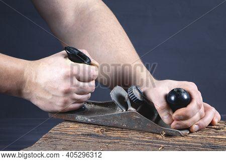 Work Of Carpenter. Handyman With Planer. Hand Holding Planer. Woodworking And Craft Of Carpenter. Ca