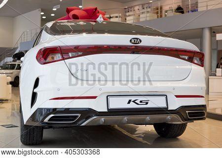 Russia, Izhevsk - December 28, 2020: Kia Showroom. New K5 Business Class Car In Dealer Showroom. Bac