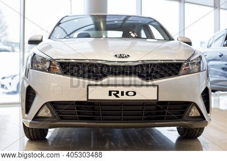 Russia, Izhevsk - December 28, 2020: Kia Showroom. New Rio Car In Dealer Showroom. Front View. Famou