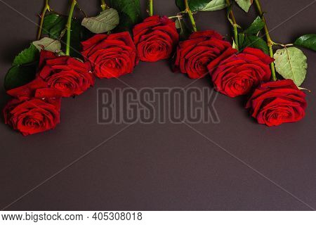 Bouquet Of Fresh Burgundy Roses On A Black Stone Concrete Background