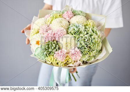 Beautiful Bouquet Of Mixed Flowers In Woman Hand. Floral Shop Concept . Handsome Fresh Bouquet. Flow