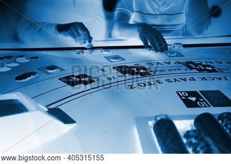 Men playing BlackJack at the casino X-ray - Shallow depth of field