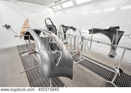 Various Parts Of The Car On The Stands For Painting. Garage Painting Car Service. Repairing Car Body