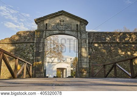 Wooden Bridge And Gate To The Colonial Old Town Of Colonia Del Sacramento, An Old Colonial City With