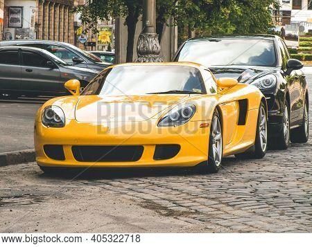 Kiev, Ukraine - June 12, 2011: Exclusive Supercar Porsche Carrera Gt Is Parked In The City. Yellow P