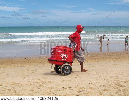Natal, Rio Grande Do Norte, Brazil - January 18, 2021: Street Vendor Works Offering His Various Prod