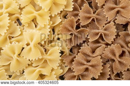 Top View Of Regular And Wholewheat Farfalle Pasta.