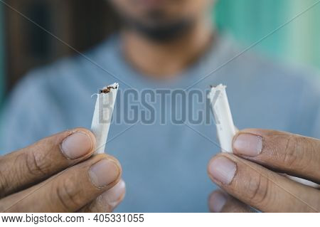 Men Quit Smoking, Young Man Holding Broken Cigarette In Hands, Stop Smoking Cigarettes Concept, No S