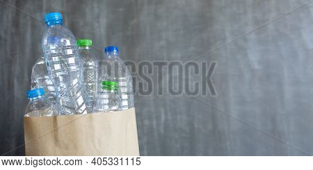 Plastic Bottle Garbage In Paper Bag For Recycling With Copy Space , Concept Reuse, Used Plastic Bott