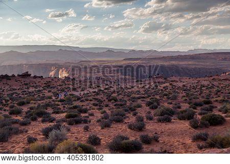 Horseshoe Bend, Arizona / Usa - October 25, 2014:  Several Tourists Dot The Landscape At Horseshoe B