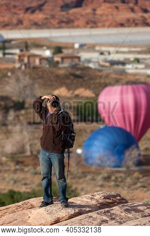 Page, Arizona / Usa - October 31, 2014:  A Photographer Takes Photos Of Festive Balloons At The Annu