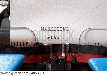 Marketing plan phrase written with a typewriter.