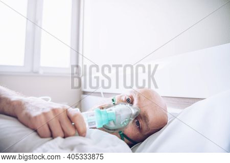 Sick Patient Man Breathing With Oxygen Mask