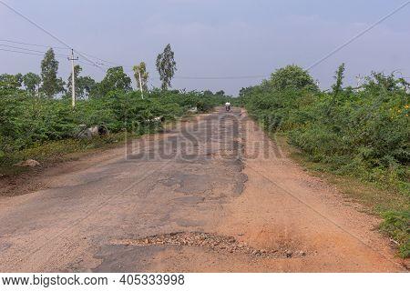 Pattadakai, Karnataka, India - November 7, 2013: Road 14 With More Potholes Than Flat Surface And Di