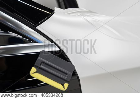 Wrapping The Car With Self-adhesive Foil. Changing Car Color