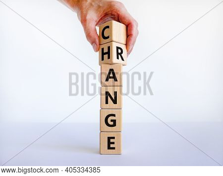 Change Range Symbol. Businessman Turns Cubes And Changes The Word 'change' To 'range'. Beautiful Whi