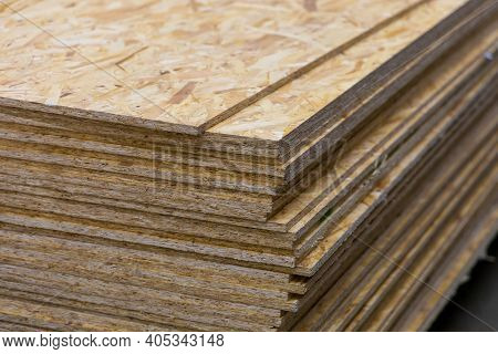 Osb - Oriented Strand Board. Sheet Stack In A Construction Store. Engineered Wood Product For Load-b