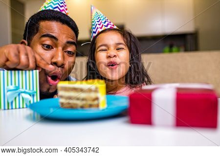 Mixed Race Family Habing Birthday Party In Kitchen