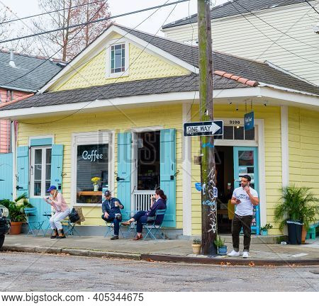 New Orleans, La - January 23, 2021: Patrons Stand And Sit At Tables In Front Of Petite Clouet Cafe O